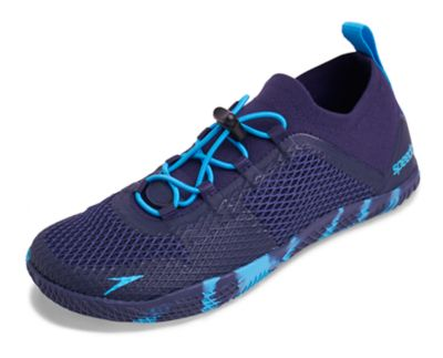 Speedo USA  Unisex Women's Fathom AQ Water Shoes Footwear : Navy/Blue: Fathom the possibilities. High-intensity aquatic workouts calls for a performance training shoe. This minimalist pair features lightweight knit construction that molds to the foot for a barefoot feel. Drainage technology ensures less water absorption and quicker drying time  while superior rubber traction keeps you grounded in and out of the pool.